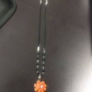 Necklace with glass flower charm